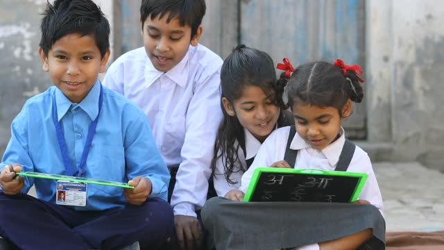 school children writing on slate - western script stock videos & royalty-free footage