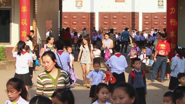 WS ZI SLO MO School childrenwalking out after  school hours / Vientiane, Laos