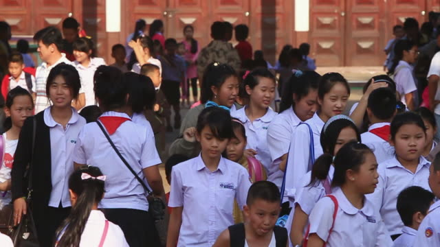 ms slo mo school childrenwalking out after  school hours / vientiane, laos  - laos stock videos & royalty-free footage
