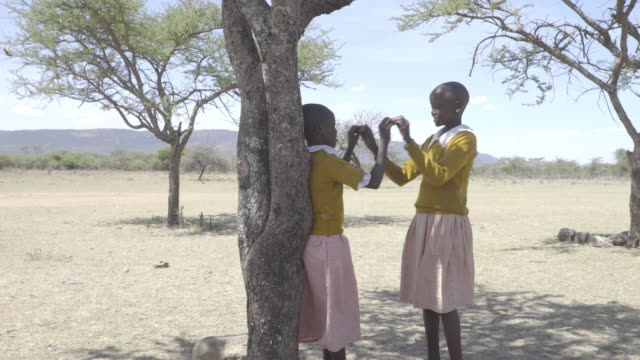 stockvideo's en b-roll-footage met school chrildren. kenya. africa. - schaduwe