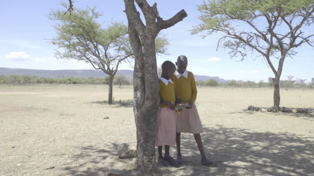 school chrildren. kenya. africa. - only girls stock videos and b-roll footage