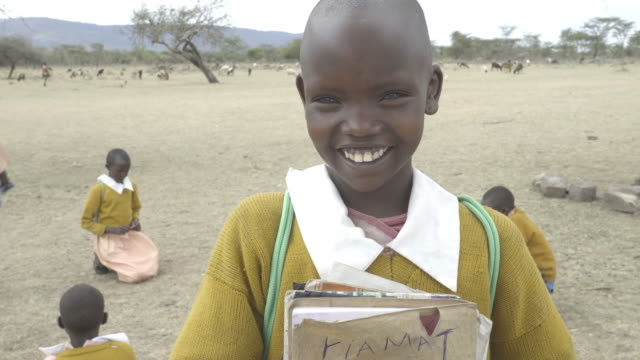 school chrildren. kenya. africa. - schoolgirl stock videos & royalty-free footage