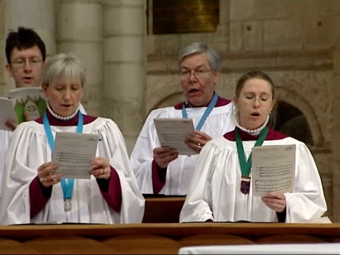 school coach crash in germany: students arrive home; england: norwich: norwich cathedral: int general views of choir & congregation at service held... - choir stock videos & royalty-free footage