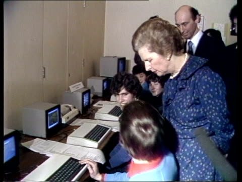stockvideo's en b-roll-footage met school computers complete london cs finger pointing to terminal screen pull out thatcher looking cms keyboard cms pupil tilt thatcher sof cs terminal... - 1981