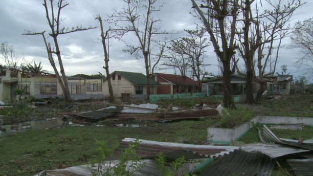 school damaged in aftermath of typhoon megi or juan in the philippines, ne luzon, philippines oct 2010 / audio - record breaking stock videos & royalty-free footage