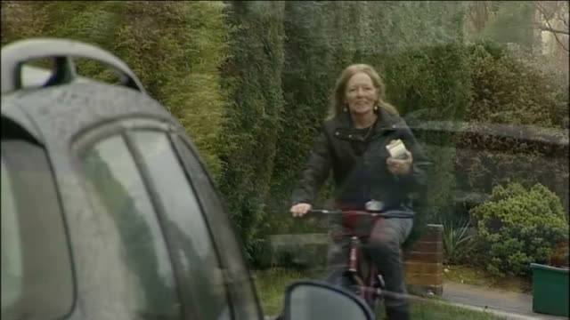 stockvideo's en b-roll-footage met school dinner lady wins claim for unfair dismissal; england: essex: ext carol hill cycling along on bicycle carol hill interview sot - so happy,... - ongerechtigheid