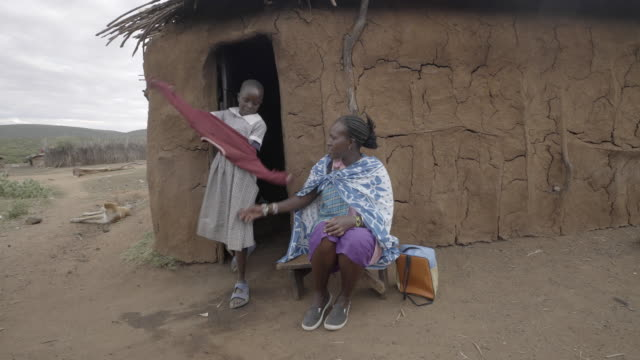 school girl leaving home for school. kenya. africa. - poor family stock videos & royalty-free footage
