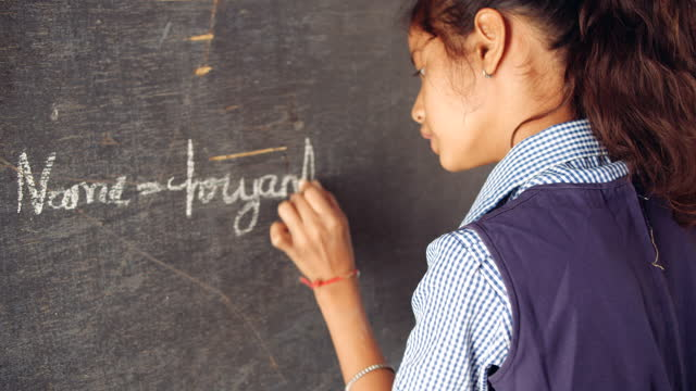 school girl writes her name with chalk on an old black board in english - one teenage girl only stock videos & royalty-free footage