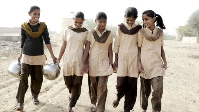 school girls collecting clean water - five people stock videos and b-roll footage