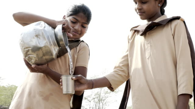 school girls collecting clean water. - drinking stock videos & royalty-free footage