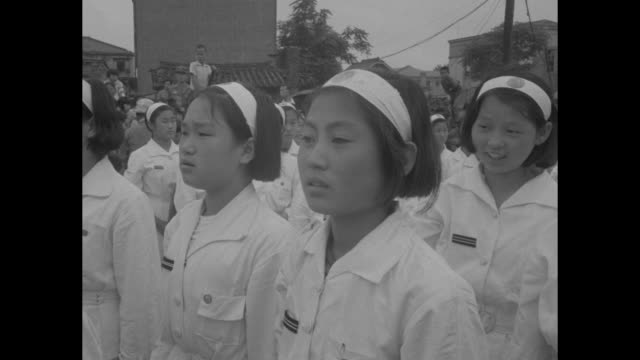 "school girls in white uniforms protest with slogans & raised fists, leader uses paper megaphone / girls march from protesting in front of sign ""seoul... - megaphone stock videos & royalty-free footage"
