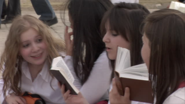 school girls reading - schoolgirl stock videos and b-roll footage