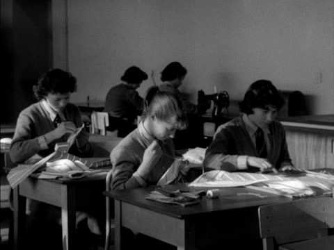 School girls take part in a sewing class at Woodberry Down Comprehensive school
