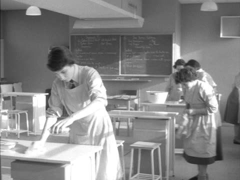 school girls take part in home economics class at woodberry down comprehensive school - home economics class stock videos & royalty-free footage