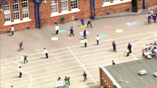 School governor of Birmingham school speaks on extremism allegations AERIAL anonymous shots school children in school playground