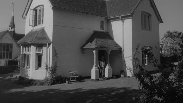 1960 MONTAGE School headmaster's house, and children filing into school / United Kingdom
