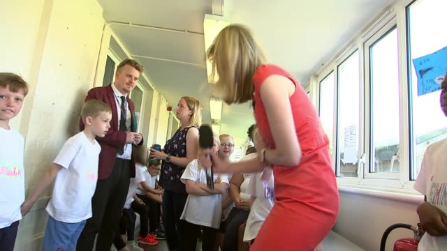 school in bexleyheath joins forces with andrew lloyd webber to create own musical england london bexleyheath ext children in circle shouting girls... - andrew lloyd webber stock videos and b-roll footage