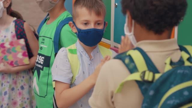 school kids having fun in school - nursery school building stock videos & royalty-free footage