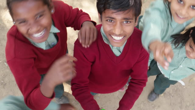 school kids in uniform taking selfies with a selfie stick and fooling around - photography themes stock videos & royalty-free footage
