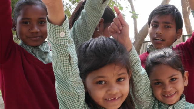 school kids jumping with joy and raising their hands, handheld - schoolgirl stock videos & royalty-free footage
