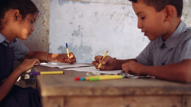 school kids, one girl, one boy attending an art class as they share sketch pens and one of them think on what to draw - pencil icon stock videos & royalty-free footage
