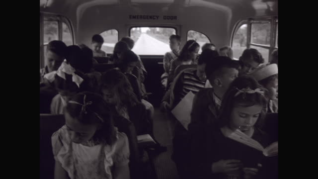 ms school kids reading books while traveling in school bus / united states - schoolboy stock videos and b-roll footage