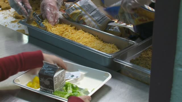 wxmi school lunches served at an elementary school cafeteria in grand rapid michigan on september 15 2015 - cafeteria worker stock videos and b-roll footage