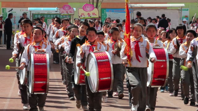 ms school marching band at school sports meeting audio / xi'an, shaanxi, china - marching band stock videos and b-roll footage