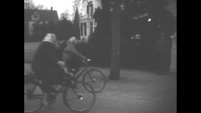 school / montage princesses beatrix and margriet approach, riding bicycles on beatrix's 18th birthday; they turn into driveway of house / the two... - schoolhouse stock videos & royalty-free footage