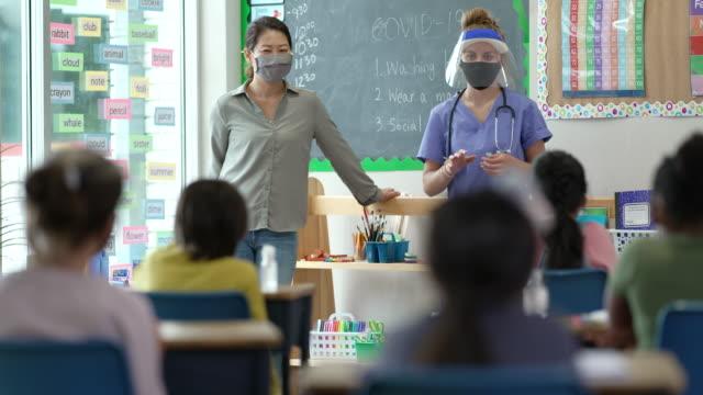 school nurse discussing coronavirus vaccine - pacific islanders stock videos & royalty-free footage