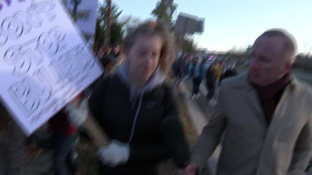 school pupils stage mass walkout in gun law protest washington ext vox pops student marching along in demonstration calling for greater gun control/... - protesta contro la violenza armata video stock e b–roll