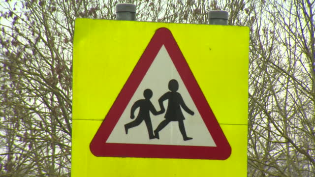 school safety zone road sign - road sign stock videos & royalty-free footage