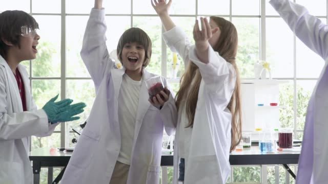 school students cheering in the lab classroom - school science project stock videos & royalty-free footage