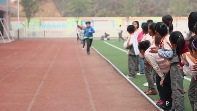 ms school students running a race on playground of school/xian,shaanxi,china - encouragement stock videos & royalty-free footage