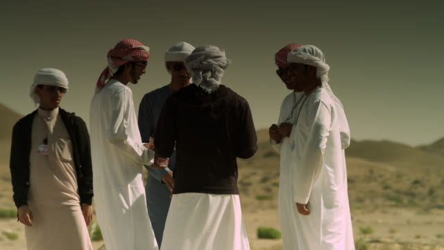 school students talking on desert field trip, uae - dish dash stock videos & royalty-free footage