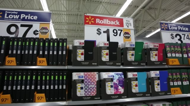 school supplies are displayed for sale at a walmart stores inc location in the porter ranch neighborhood of los angeles california us on thursday... - 学校備品点の映像素材/bロール