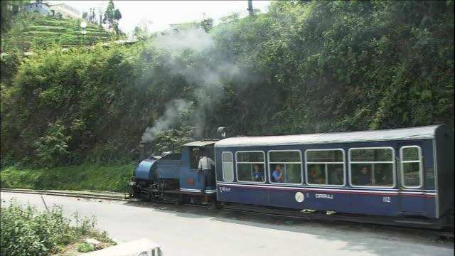 school train, rail tracks, darjeeling himalayan railway - rail transportation stock videos and b-roll footage