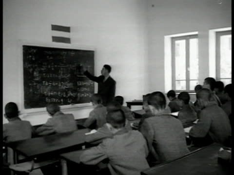 school yard outside large school older & younger students together. int math classroom w/ male teacher at blackboard mixed age of males sitting at... - television show stock videos & royalty-free footage