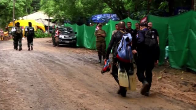 first four of the 12 boys trapped in a flooded cave are freed thailand chiang rai tham luang nang non cave complex ext scuba divers along - aqualung diving equipment stock videos & royalty-free footage