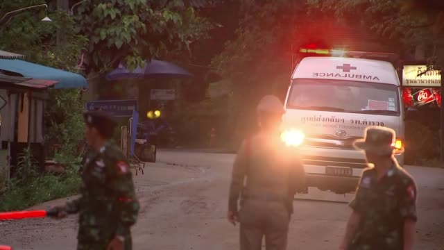 first four of the 12 boys trapped in a flooded cave are freed thailand chiang rai tham luang nang non cave complex ambulance convoy along road... - 解放する点の映像素材/bロール