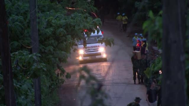 four more boys rescued from cave thailand chiang rai chiangrai prachanukroh hospital ext traffic along hospital entrance ambulance parked doi nang... - itv放送点の映像素材/bロール