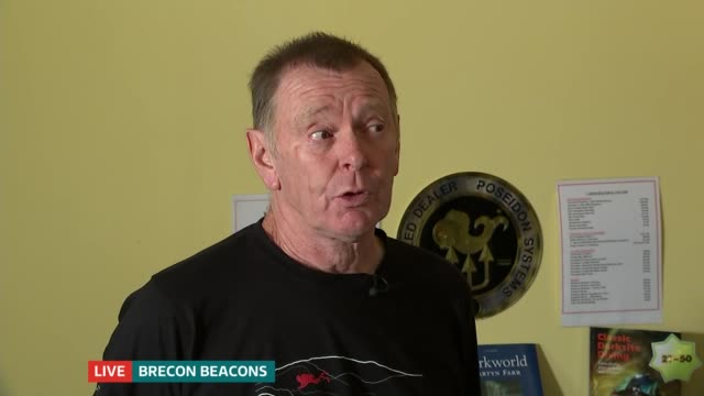 rescue teams consider rescue options LIVE WALES Brecon Beacons INT Martyn Farr interview SOT