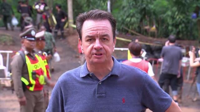 vídeos y material grabado en eventos de stock de rescue teams consider rescue options thailand chiang rai province tham luang nang non caves ext reporter to camera - itv