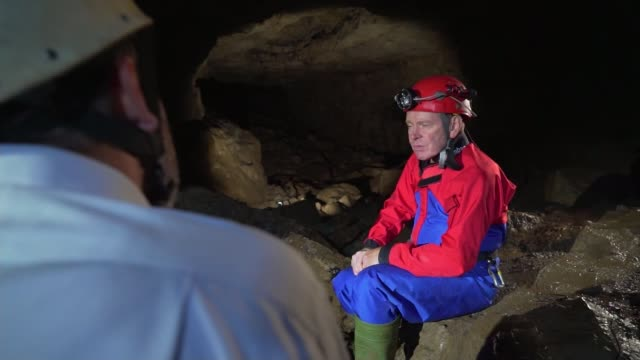 rescue teams consider rescue options wales brecon beacons caves caving cave rescues martyn farr interview wales brecon beacons ext gvs mountains and... - rescue stock videos & royalty-free footage