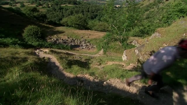 Two British divers first to discover schoolboys WALES EXT **Farr interview partly overlaid SOT** Martyn Farr and report climbing hill Low angle view...