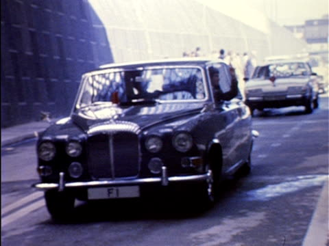 schoolboy glen martin waves from an official car as the new dartford tunnel is opened. 16 may 1980. - m25 video stock e b–roll