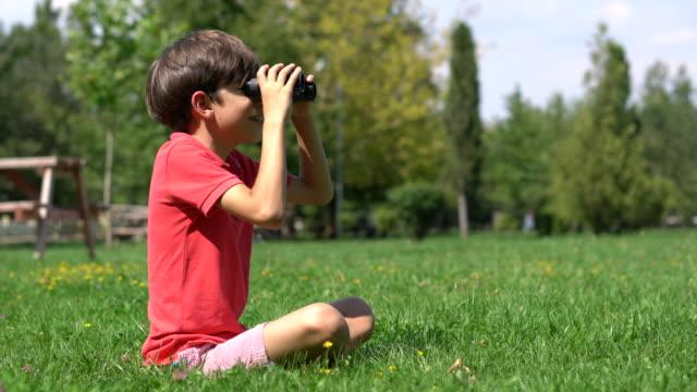 schoolboy looks through the binoculars - binoculars stock videos & royalty-free footage