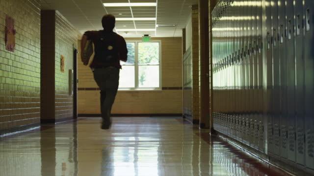 WS Schoolboy (16-17) running down school corridor / Spanish Fork City, Utah, USA