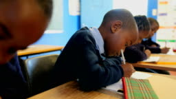 Schoolboy studying in the classroom at school 4k