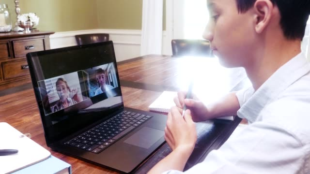 schoolboy talks with teacher via video call during coronavirus pandemic - high school student stock videos & royalty-free footage